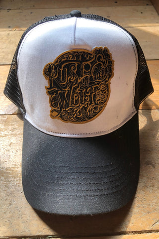 Rust And The Wolf Logo Black Trucker Cap.
