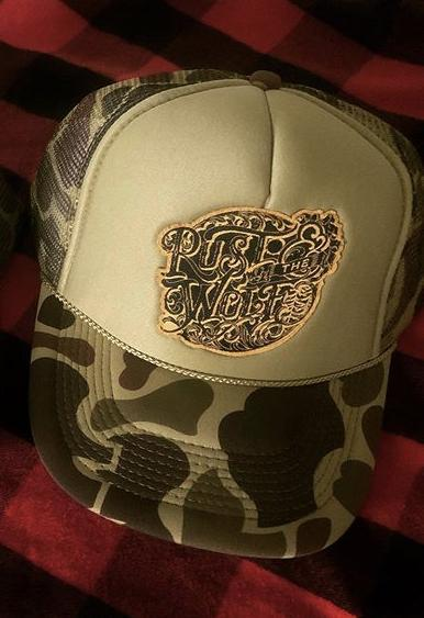 Rust And The Wolf logo Camo Trucker Cap