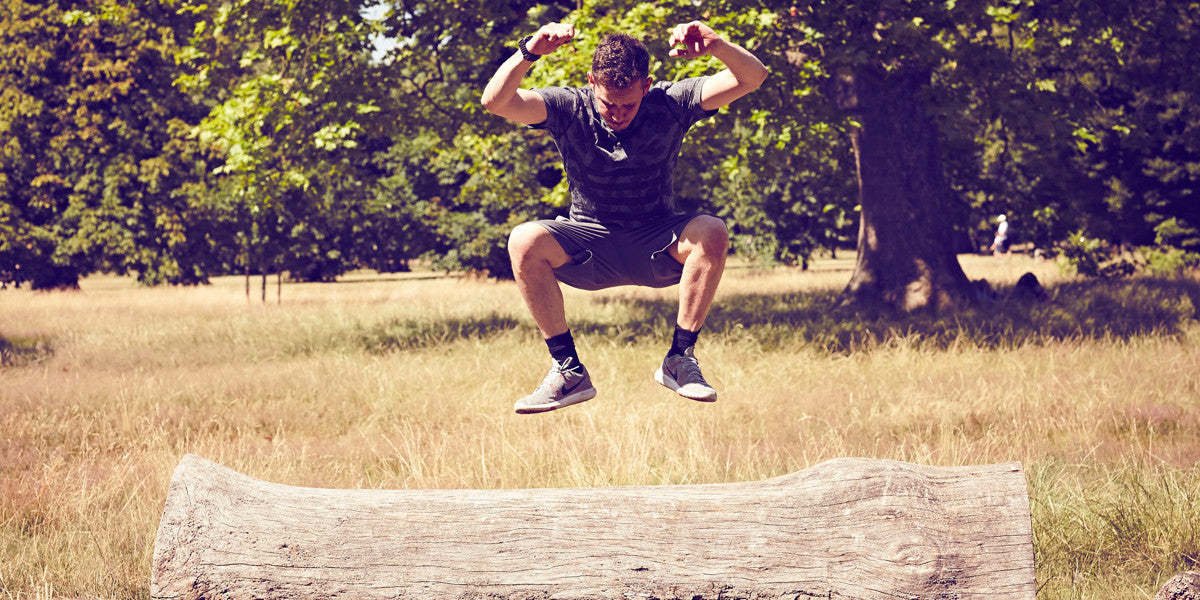 Personal Trainer Jumping Outdoors Workout
