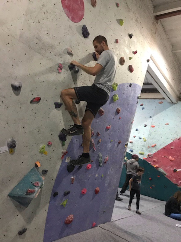 Male AThlete Rock Climbing wearing Sundried Recycled Eco Tech Activewear