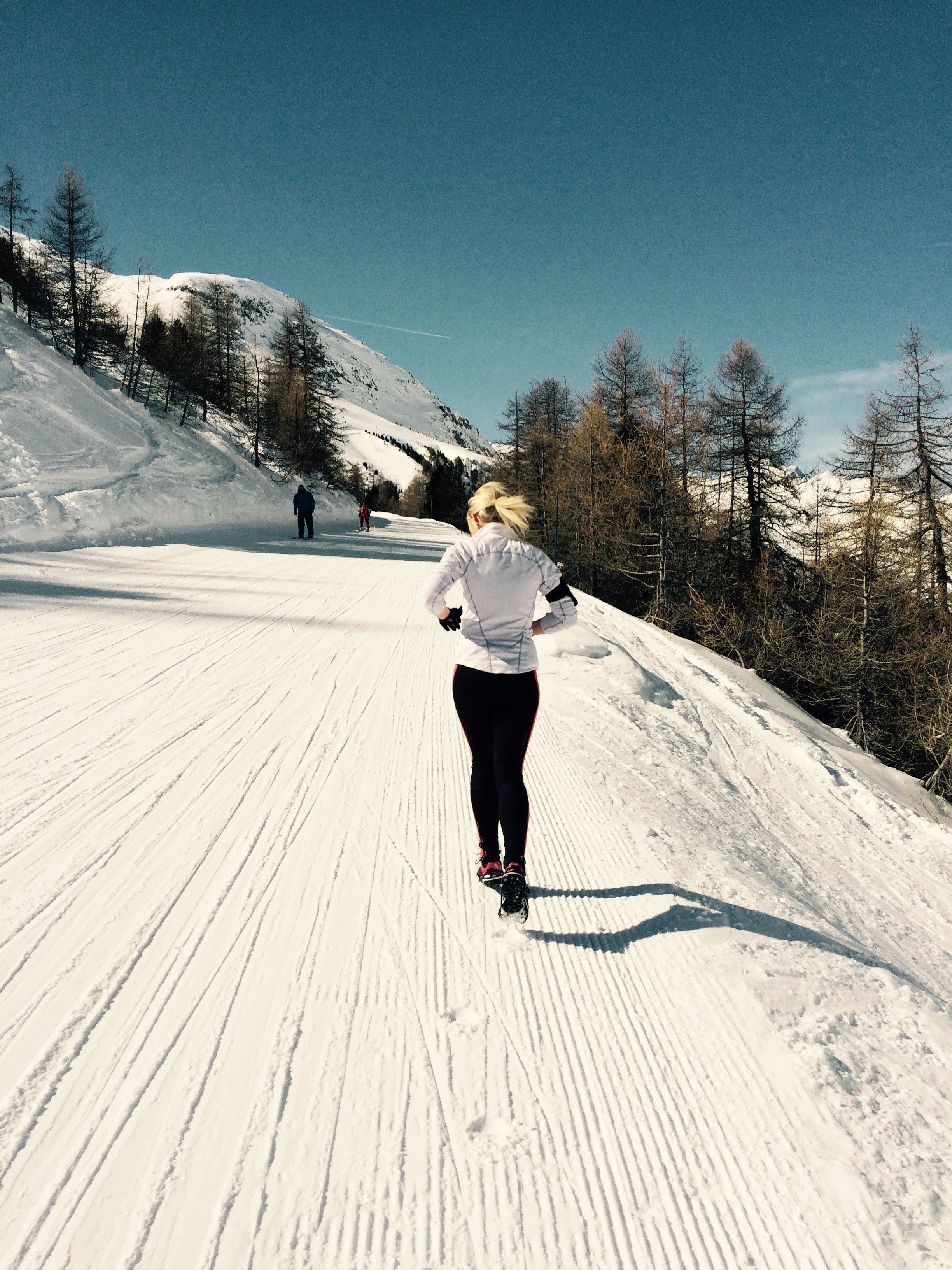 Woman Running Uphill Ski Slope Winter Snowing