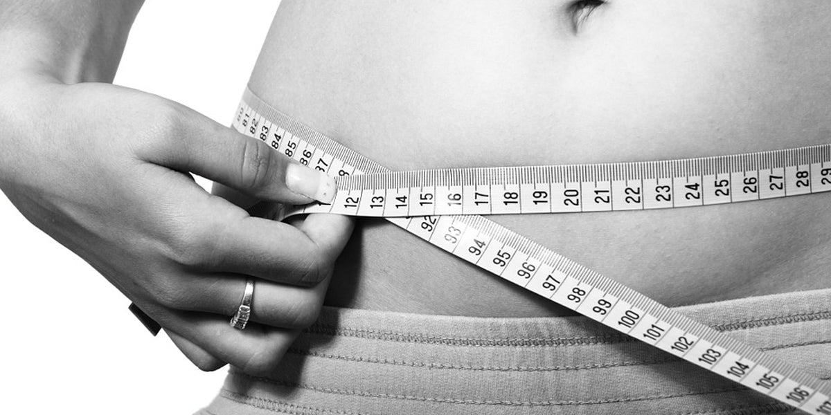 black and white image of measuring tape belly