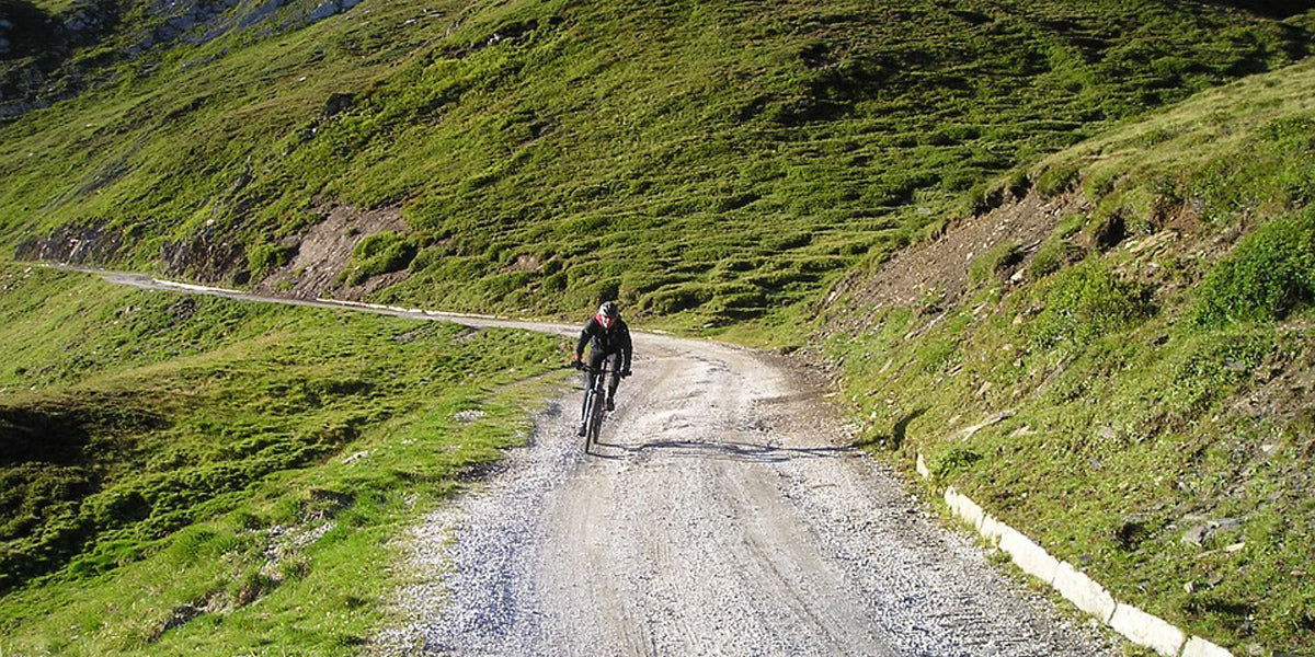 cycling uphill road bike mountain climb