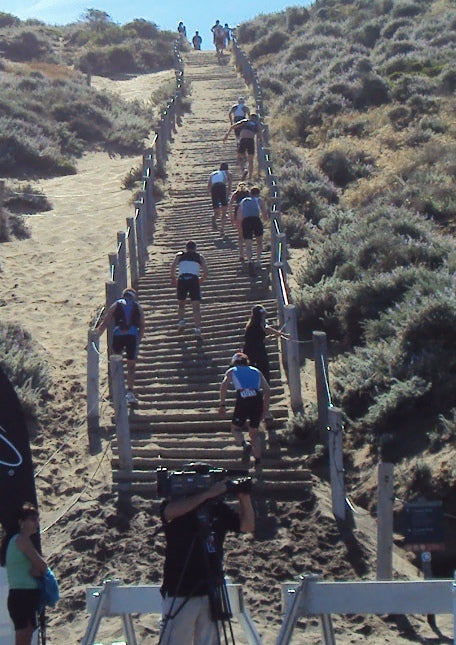 Escape From Alcatraz run climb stairs sand beach