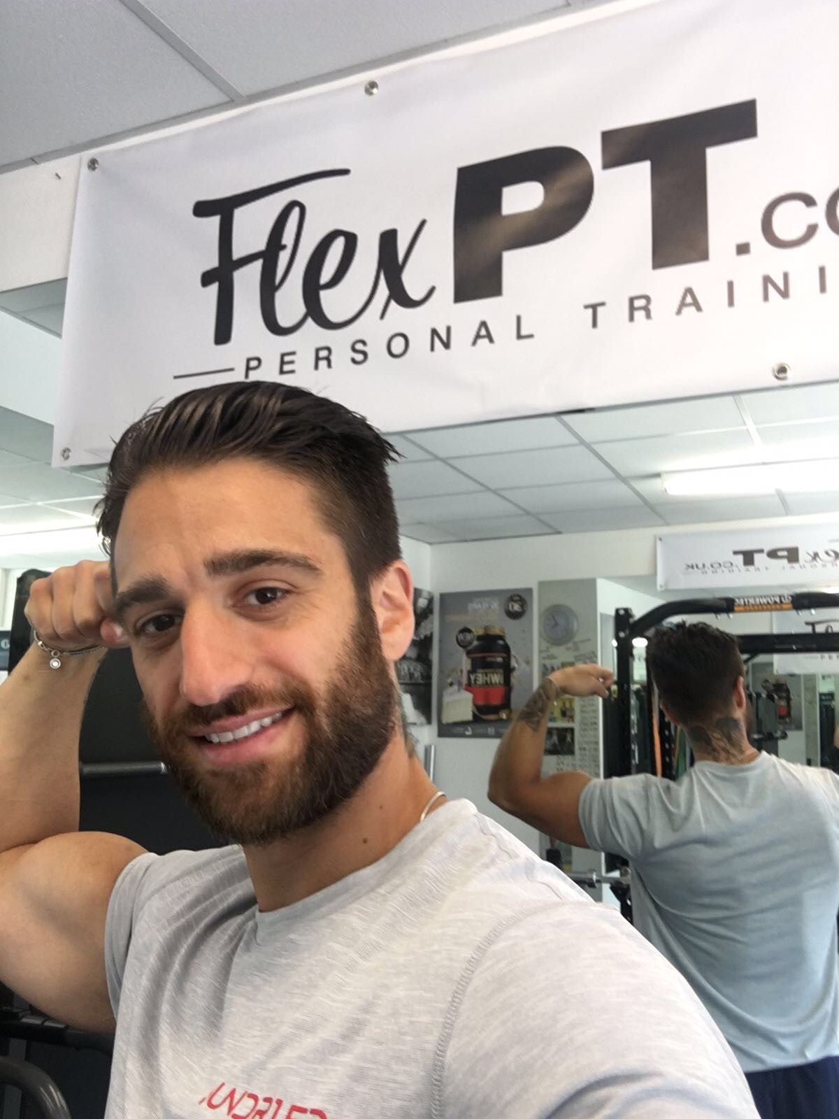 Flex Personal Trainer Bicep Strong Gym Smiling