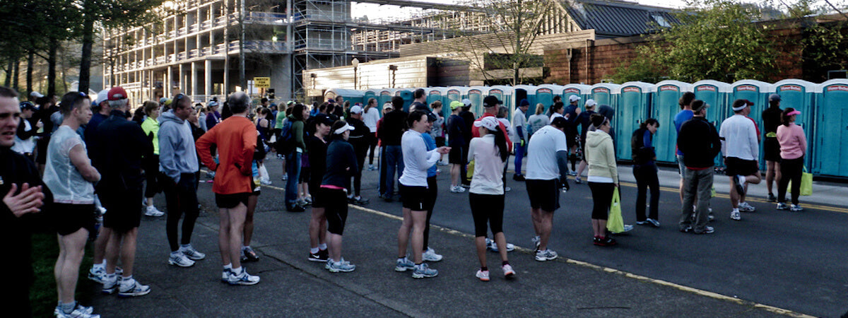 portable toilets queues racing running
