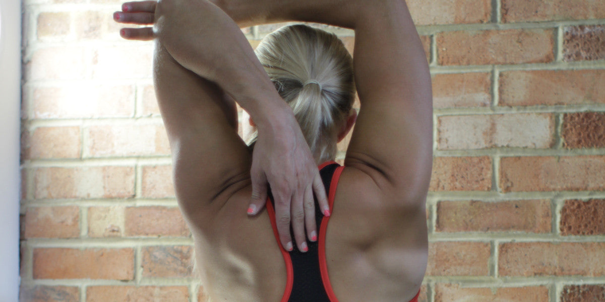 Stretching UKBFF Triceps Muscles Female Bodybuilder