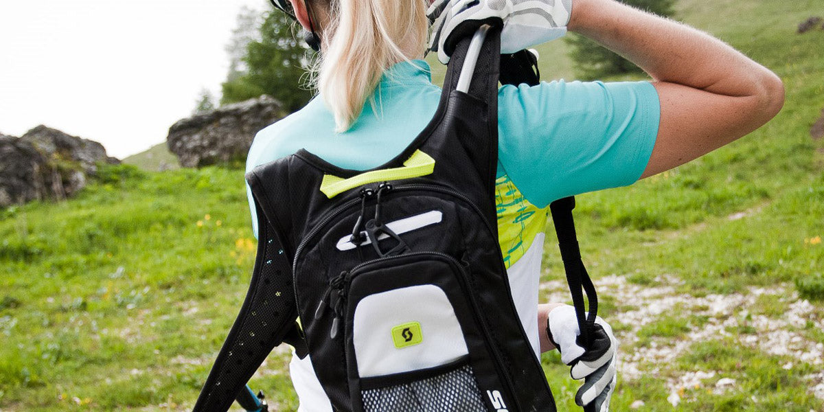 trail running essential kit hydration pack