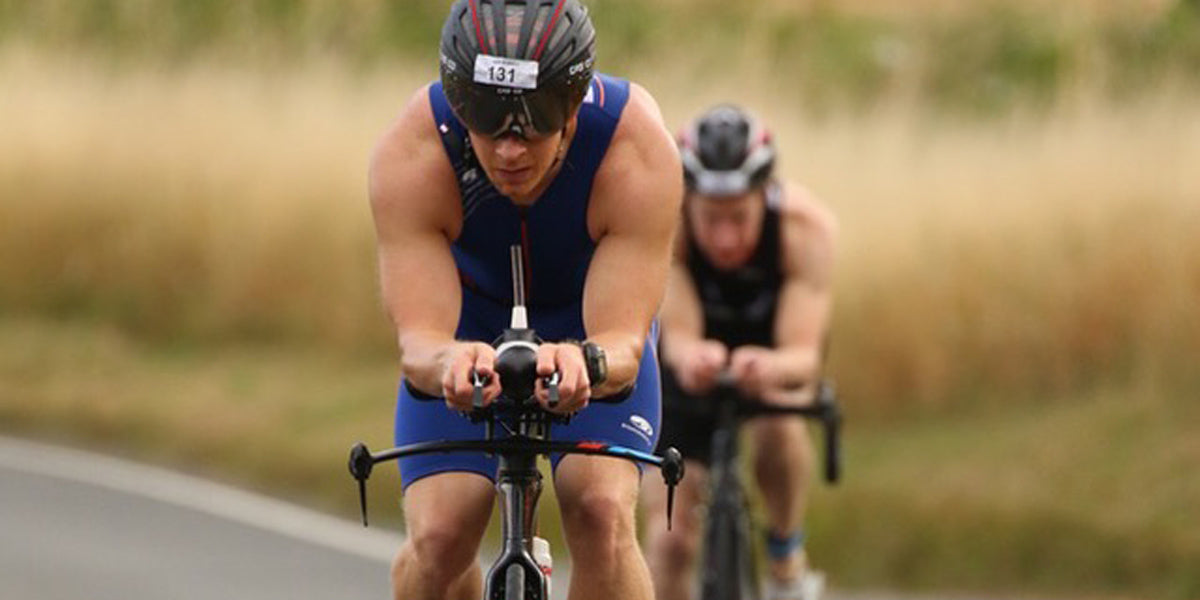 triathlete racing bike cycling