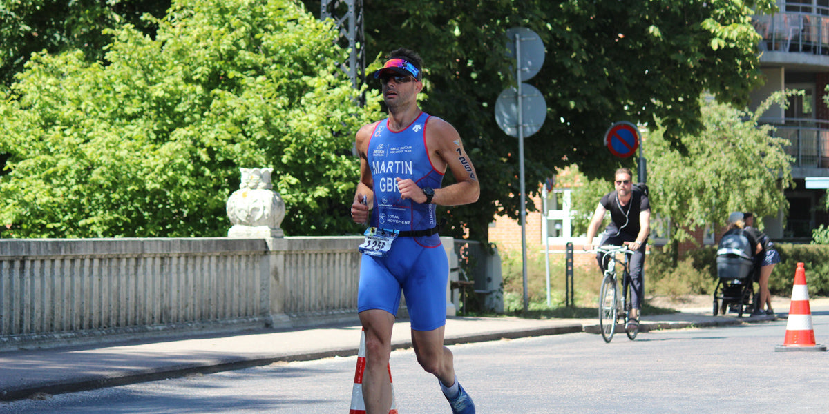 triathlete running racing trisuit
