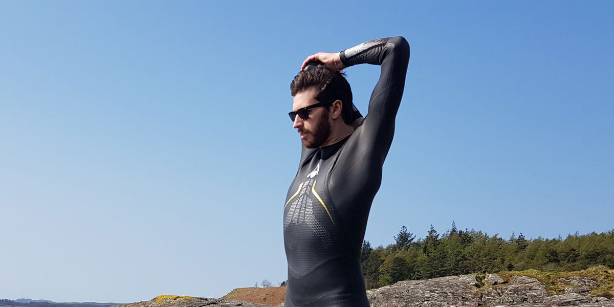 triathlete stretching wetsuit swim