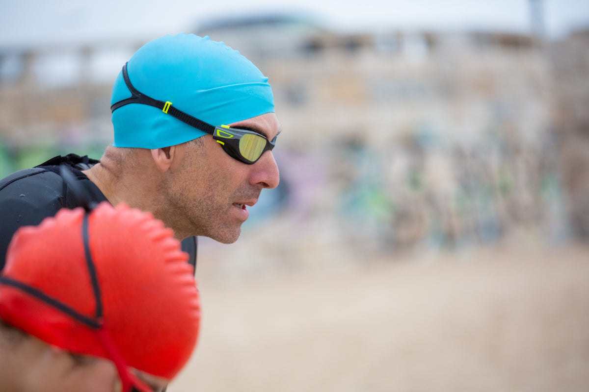 triathletes swimmers beach