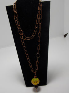 Hollow yellow bead necklace by Sherrie Cocanougher