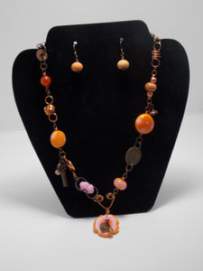Coral/Pink necklace and earring set by Sherrie Cocanougher