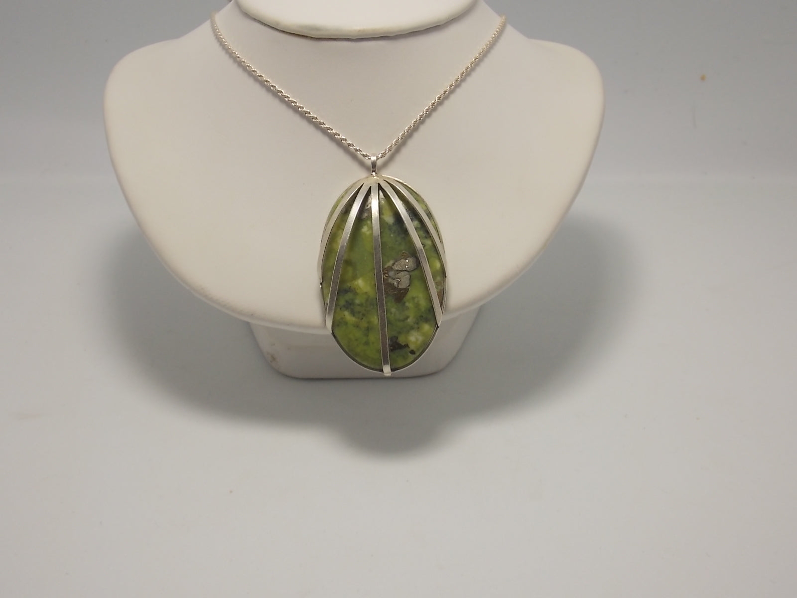 Sterling silver and serpentine and piryte pendant by Balbina Meyer