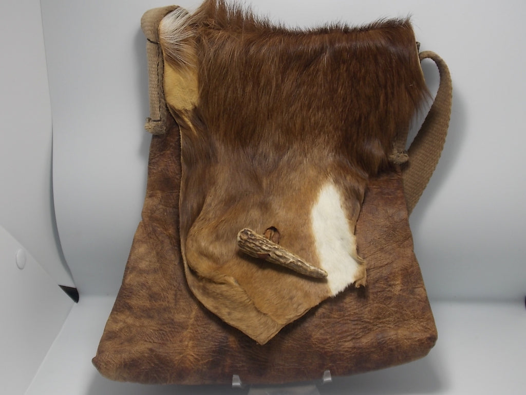 Whitetail deer neck bag by Russel Dahlstrom