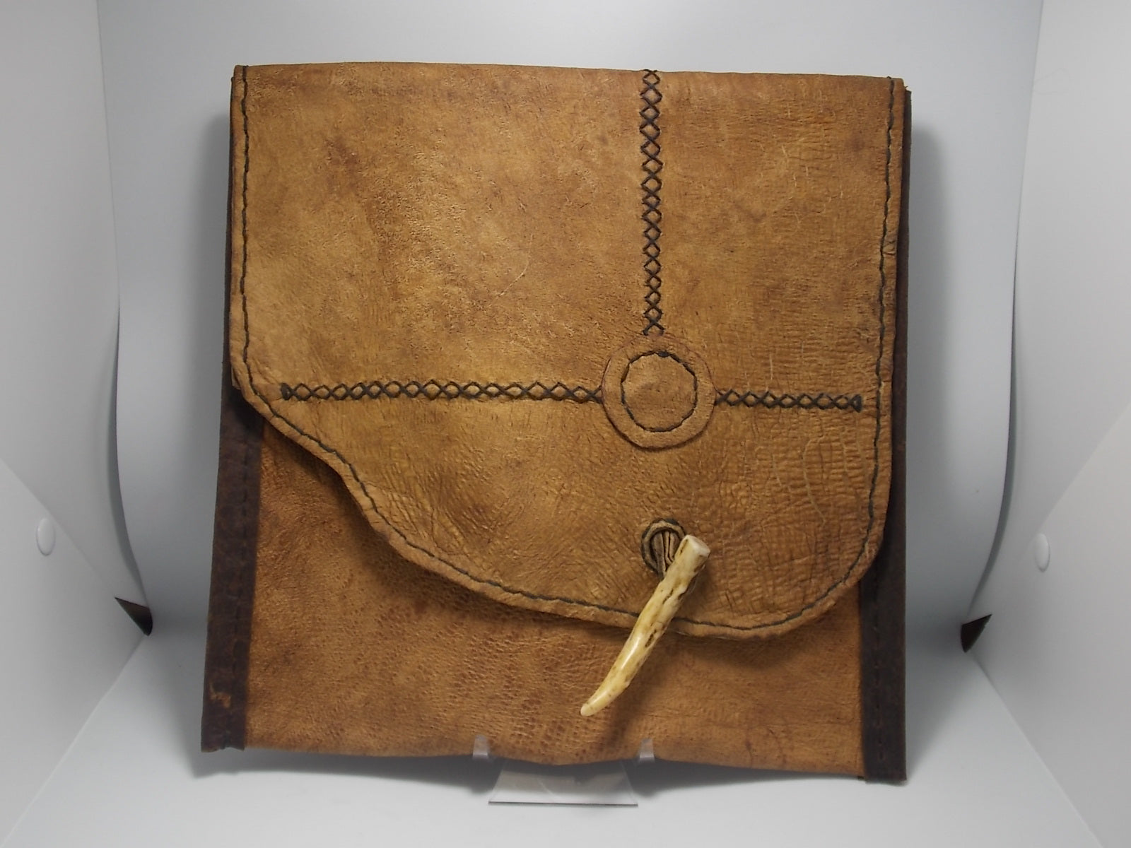 Bark tanned whitetail deer bag by Russel Dahlstrom