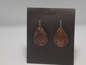 Copper embossed earrings by Rebecca Wheat