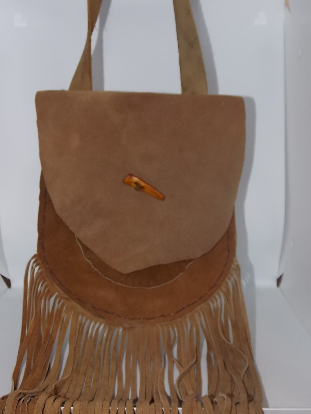 Fringed leather bag by Russel Dahlstrom