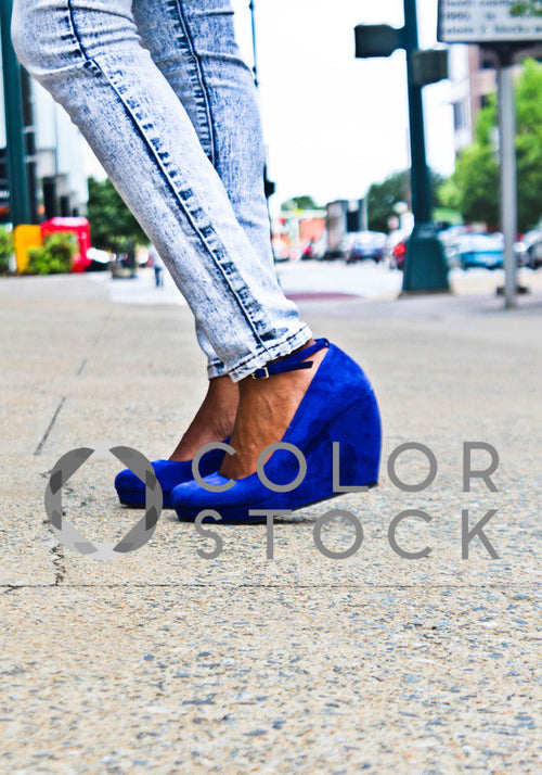 Close up of woman's shoes on a city street - Colorstock™  © Tee Dubose  - diverse stock photos