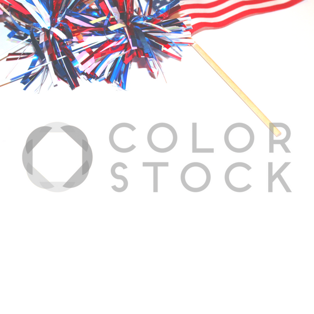 Flat Lay - Red, white, and blue pompoms and American flag - top - Colorstock™  © L Danielle Baldwin  - diverse stock photos
