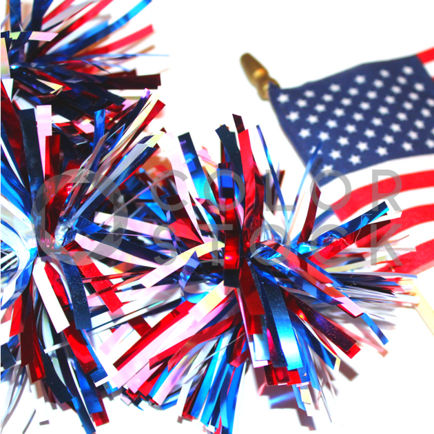 Flat Lay - Red, white, and blue pompoms and American flag - Colorstock™  © L Danielle Baldwin  - diverse stock photos