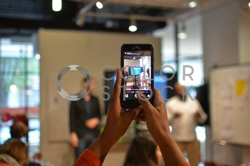 Pitch meeting through the lens of a smartphone