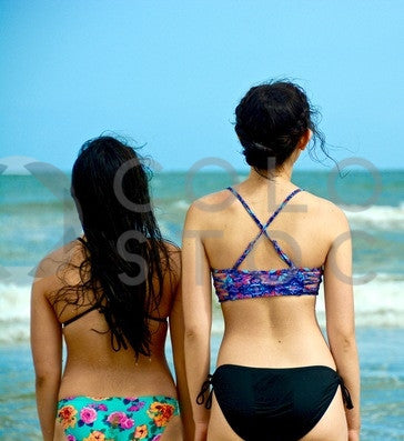 Girls from behind at the beach - Colorstock™  © Anna-Rhesa Versola  - diverse stock photos