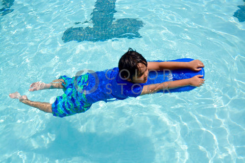 Boy using floatie in the pool - Colorstock™  © Anna-Rhesa Versola  - diverse stock photos