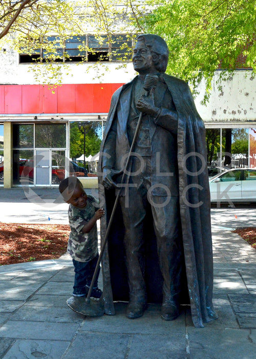 Child standing near statue in downtown - Colorstock™  © Anna-Rhesa Versola  - diverse stock photos