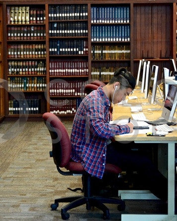 College student working on computer in library - Colorstock™  © Anna-Rhesa Versola  - diverse stock photos