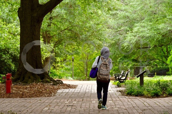 College student walking on campus grounds - Colorstock™  © Anna-Rhesa Versola  - diverse stock photos