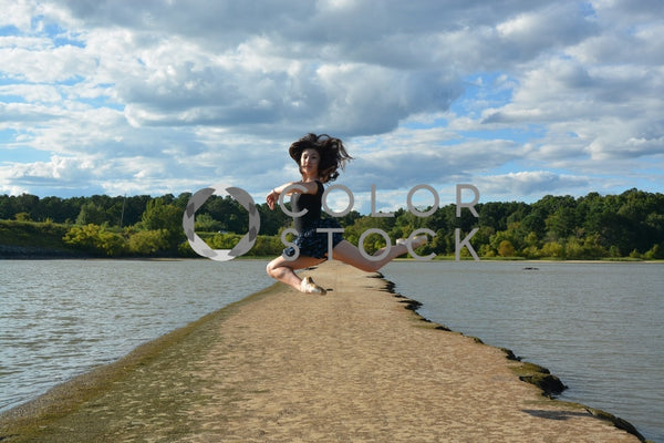 Ballet dancer jumping in air - set against lake - Colorstock™  © Anna-Rhesa Versola  - diverse stock photos