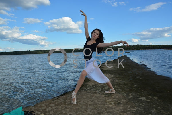 Ballet dancer looking at camera - set against lake - Colorstock™  © Anna-Rhesa Versola  - diverse stock photos