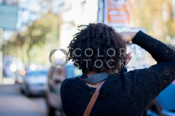 Photographer on city street, Denise Benson Photography - Colorstock: diverse stock photos