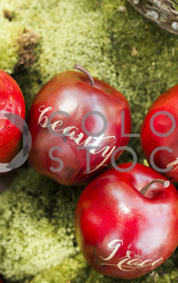 Apples on green background - vertical
