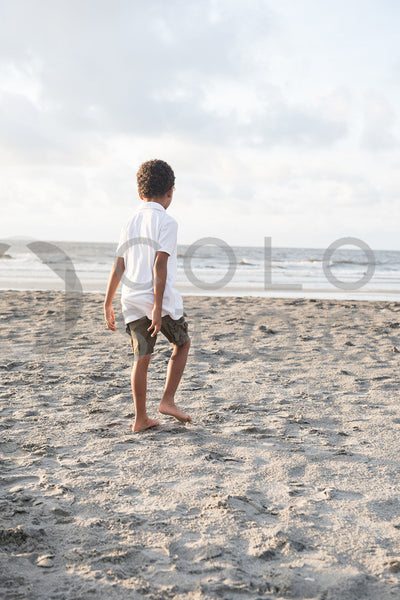 Little boy on the beach - Colorstock™  © Sirena White  - diverse stock photos