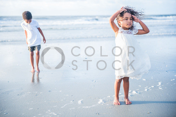 Two children playing on the beach - Colorstock™  © Sirena White  - diverse stock photos