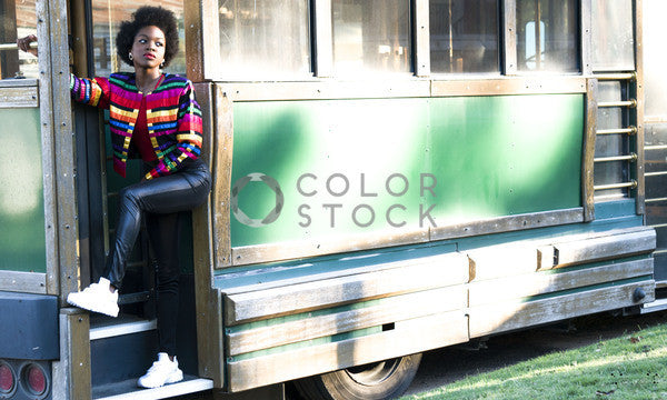 Woman posed against green trolley, Stephanie Warren - Colorstock: diverse stock photos