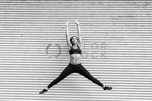 Runner jumping in the air - B&W - Colorstock™  © Click Clique NYC  - diverse stock photos