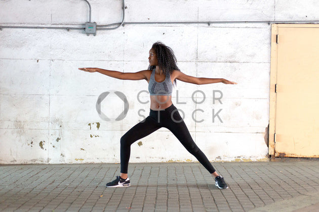 Yogi in warrior one position - Colorstock™  © Click Clique NYC  - diverse stock photos