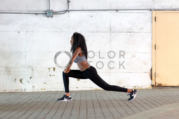 Yogi in crescent lunge position - Colorstock™  © Click Clique NYC  - diverse stock photos