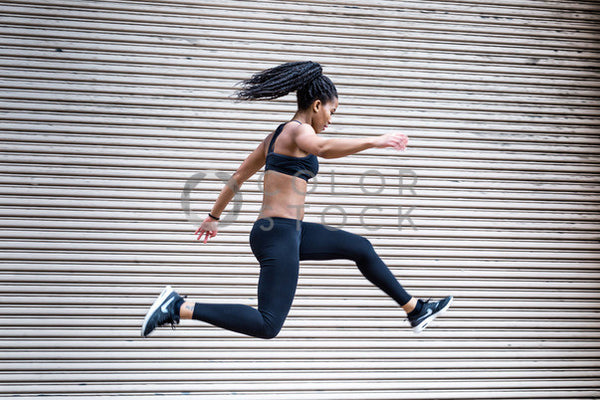 Runner jumping in the air - 4 - Colorstock™  © Click Clique NYC  - diverse stock photos