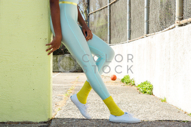 Aerobics class member in spandex - legs - Colorstock™  © Click Clique NYC  - diverse stock photos