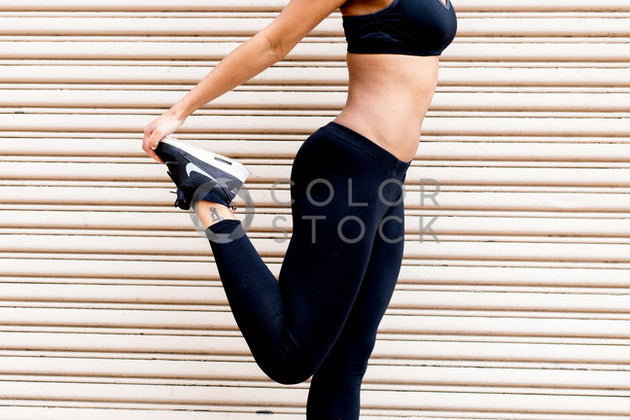 Runner stretches her calf muscle - Colorstock™  © Click Clique NYC  - diverse stock photos