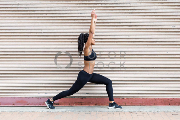 Runner stretching in front of a wall - Colorstock™  © Click Clique NYC  - diverse stock photos