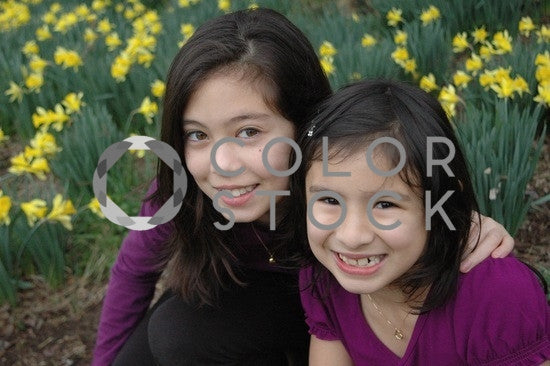 Two young friends smiling - Colorstock™  © Anna-Rhesa Versola  - diverse stock photos