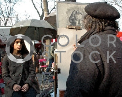Woman getting her portrait drawn on street - Colorstock™  © Anna-Rhesa Versola  - diverse stock photos
