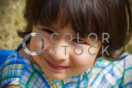 Girl smiling at the camera - close up - Colorstock™  © Anna-Rhesa Versola  - diverse stock photos