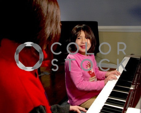 Girl during piano lesson - Colorstock™  © Anna-Rhesa Versola  - diverse stock photos